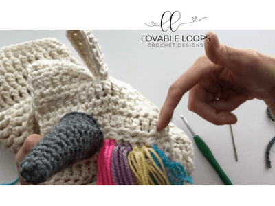 Pull the 4 loose ends through the loop (folded section) and tie to create a knot.